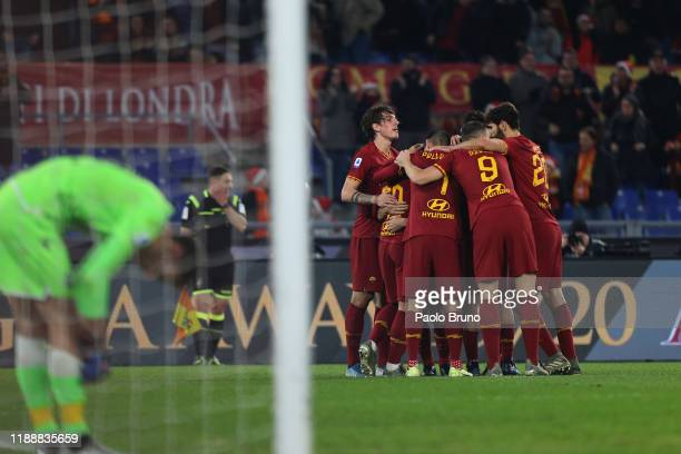 Henrikh Mikhitaryan with his teammates of AS Roma celebrates after scoring the team's third goal during the Serie A match between AS Roma and SPAL at...