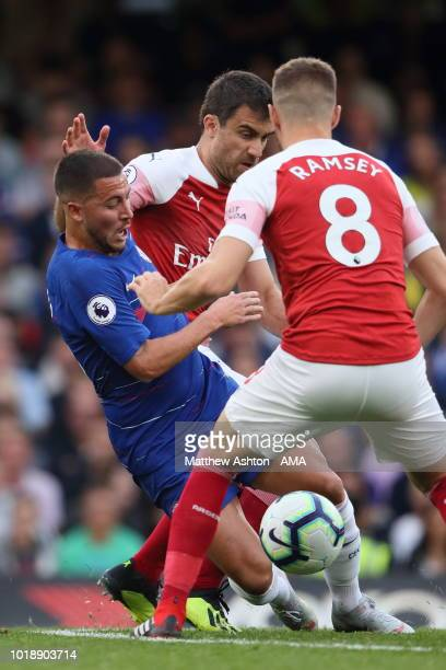 Henrikh Mkhitaryan and Aaron Ramsey of Arsenal close in on Eden Hazard of Chelsea during the Premier League match between Chelsea FC and Arsenal FC...