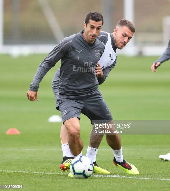 Henrikh Mkhitaryan and Aaron Ramsey of Arsenal during a training session at London Colney on August 10 2018 in St Albans England