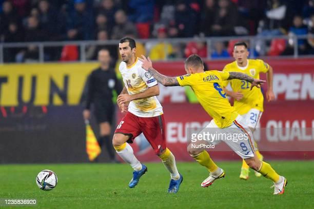 Henrikh Mkhitaryan and Alexandru Cicaldau during the FIFA World Cup Qatar 2022 qualification Group J football match between Romania and Armenia in...