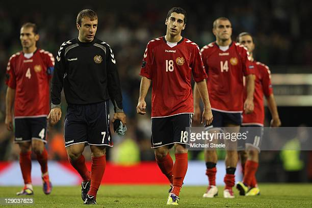 Henrikh Mkhitaryan and Artur Edigaryan of Armenia are dejected after their side lost 12 and failed to reach the playoffs during the EURO 2012 Group B...