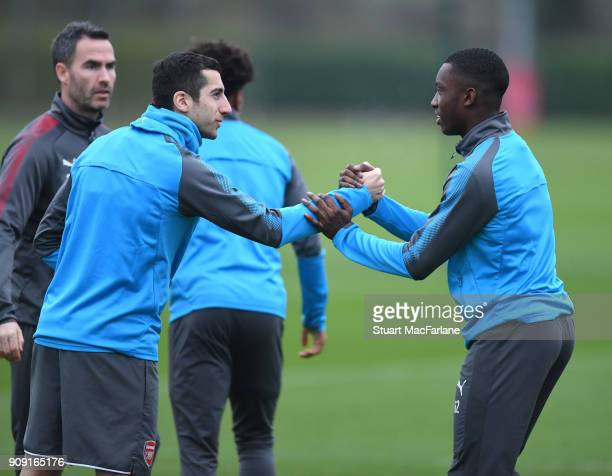 Henrikh Mkhitaryan and Eddie Nketiah of Arsenal during a training session at London Colney on January 23 2018 in St Albans England