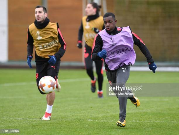Henrikh Mkhitaryan and Eddie Nketiah of Arsenal during a training session at London Colney on February 14 2018 in St Albans United Kingdom
