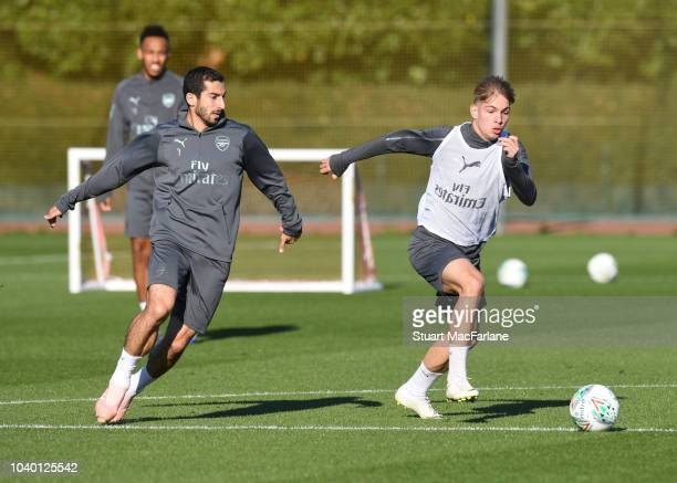 Henrikh Mkhitaryan and Emie Smith Rowe of Arsenal during a training session at London Colney on September 25 2018 in St Albans England