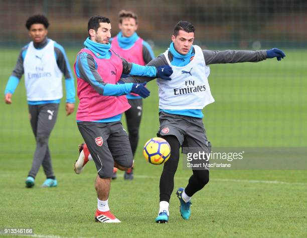 Henrikh Mkhitaryan and Granit Xhaka of Arsenal during a training session at London Colney on February 2 2018 in St Albans England