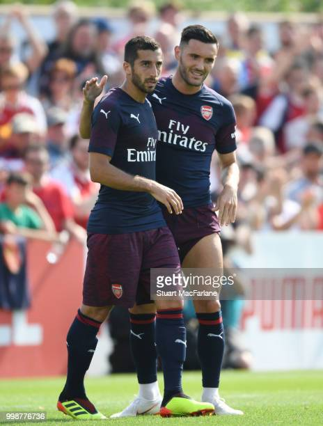 Henrikh Mkhitaryan and Lucas Perez of Arsenal smile during the preseason friendly between Boreham Wood and Arsenal at Meadow Park on July 14 2018 in...
