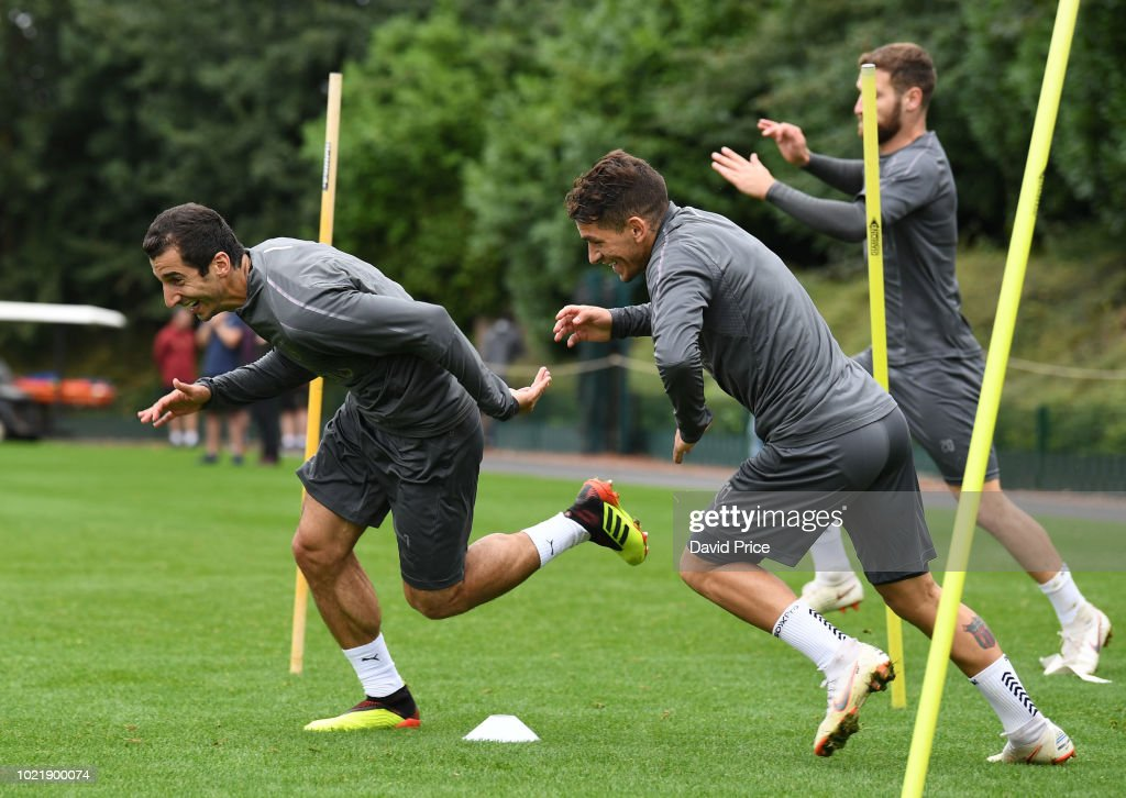 Henrikh Mkhitaryan and Lucas Torreira of Arsenal during Arsenal Training Session at London Colney on August 23, 2018 in St Albans, England.