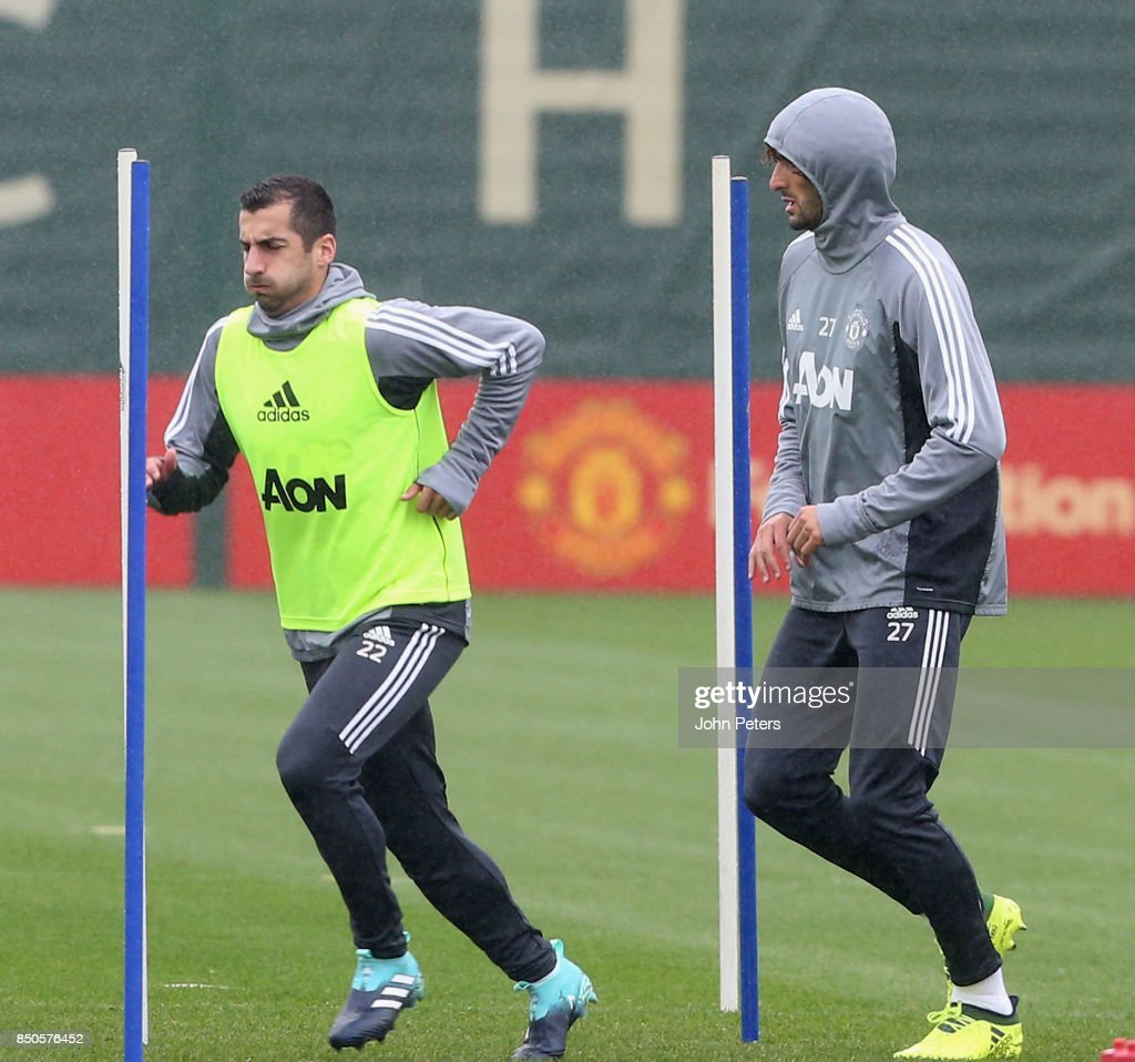 Henrikh Mkhitaryan and Marouane Fellaini of Manchester United in action during a first team training session at Aon Training Complex on September 21, 2017 in Manchester, England.