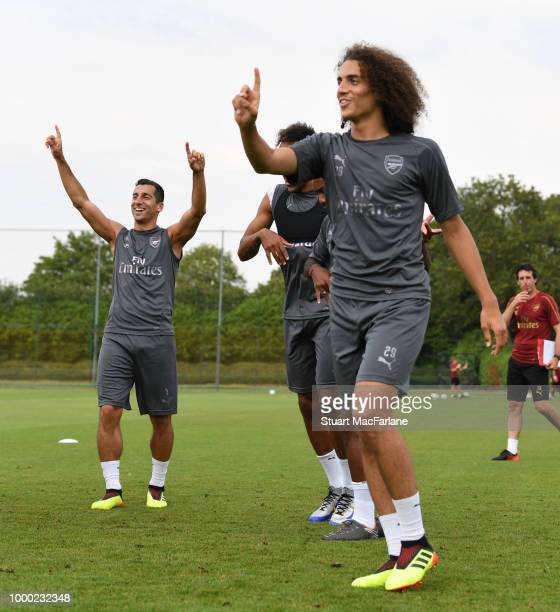 Henrikh Mkhitaryan and Matteo Guendouzi of Arsenal during a training session at London Colney on July 16 2018 in St Albans England