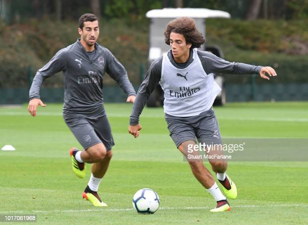 Henrikh Mkhitaryan and Matteo Guendouzi of Arsenal during a training session at London Colney on August 15 2018 in St Albans England