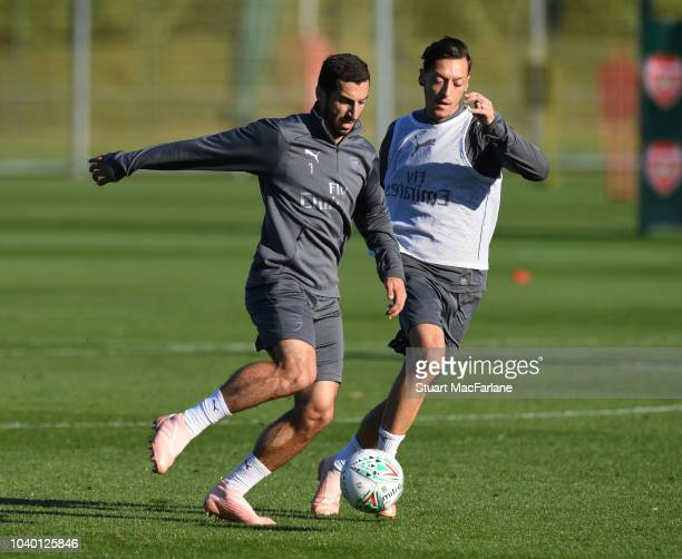Henrikh Mkhitaryan and Mesut Ozil of Arsenal during a training session at London Colney on September 25 2018 in St Albans England