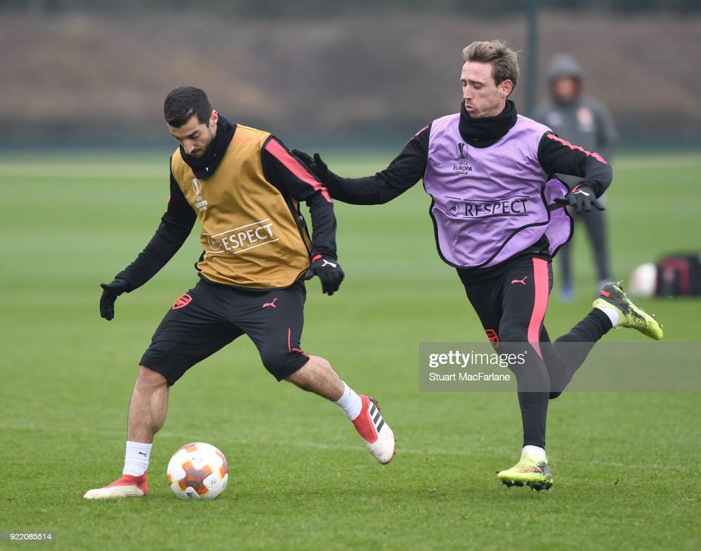 Henrikh Mkhitaryan and Nacho Monreal of Arsenal during a training session at London Colney on February 21, 2018 in St Albans, England.