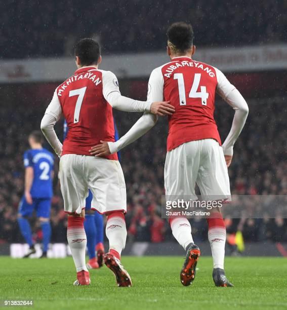 Henrikh Mkhitaryan and PierreEmerick Aubameyang of Arsenal during the Premier League match between Arsenal and Everton at Emirates Stadium on...
