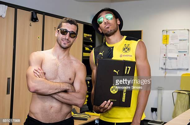 Henrikh Mkhitaryan and PierreEmerick Aubameyang of Borussia Dortmund revealing the new Borussia Dortmund home jersey Season 20162017 on May 12 2016...