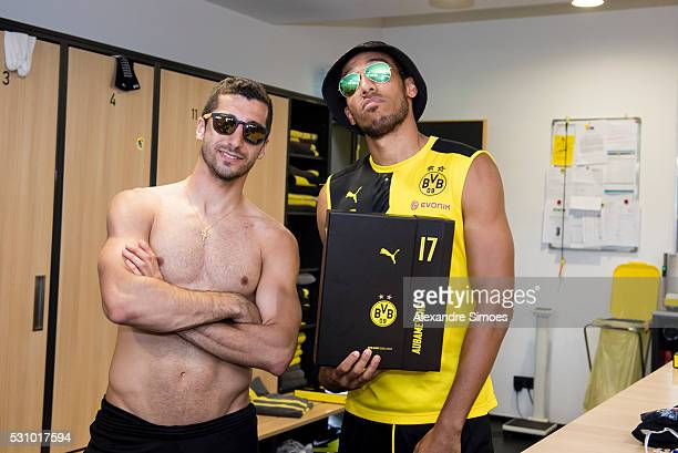 Henrikh Mkhitaryan and PierreEmerick Aubameyang of Borussia Dortmund revealing the new Borussia Dortmund home jersey Season 20162017 on May 12 2016...