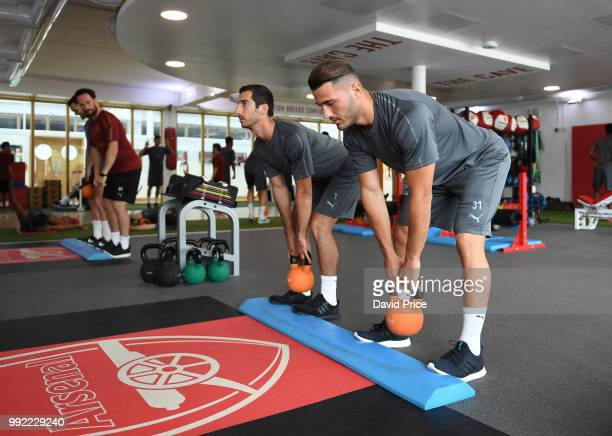 Henrikh Mkhitaryan and Sead Kolasinac of Arsenal during a preseason training session at London Colney on July 5 2018 in St Albans England