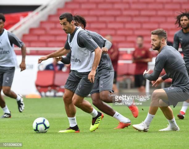 Henrikh Mkhitaryan and Shkodran Mustafi of Arsenal during a training session at Emirates Stadium on August 11 2018 in London England