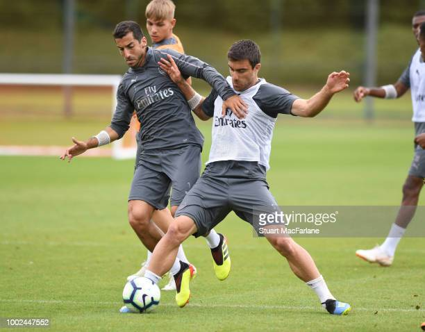 Henrikh Mkhitaryan and Sokratis of Arsenal during a training session at London Colney on July 20 2018 in St Albans England