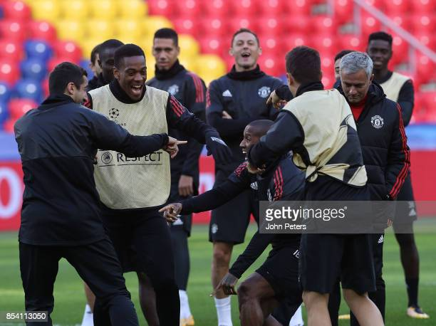 Henrikh Mkhitaryan Anthony Martial and Ashley Young of Manchester United in action during a training session ahead of their UEFA Champions League...