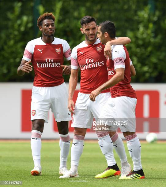 Henrikh Mkhitaryan celebrates scoring a goal for Arsenal with Jeff ReineAdelaide and Lucas Perez during the match between Arsenal XI and Crawley Town...