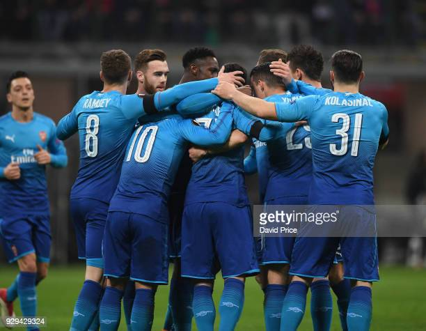 Henrikh Mkhitaryan celebrates scoring Arsenal's 1st goal with his team mates during UEFA Europa League Round of 16 match between AC Milan and Arsenal...