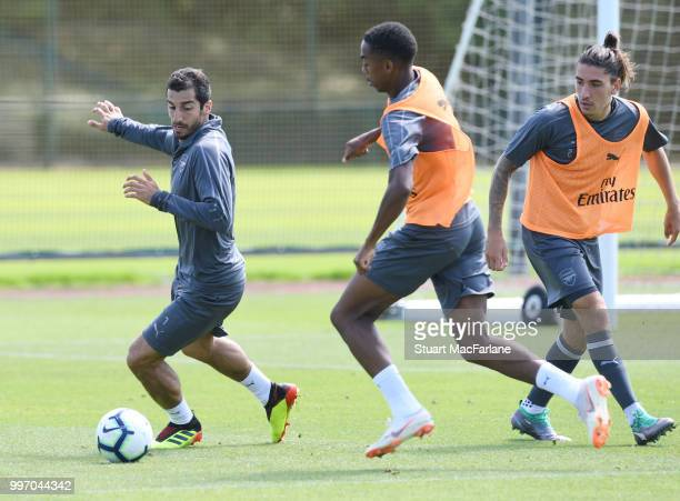 Henrikh Mkhitaryan Chuba Akpom of Arsenal during a training session at London Colney on July 12 2018 in St Albans England