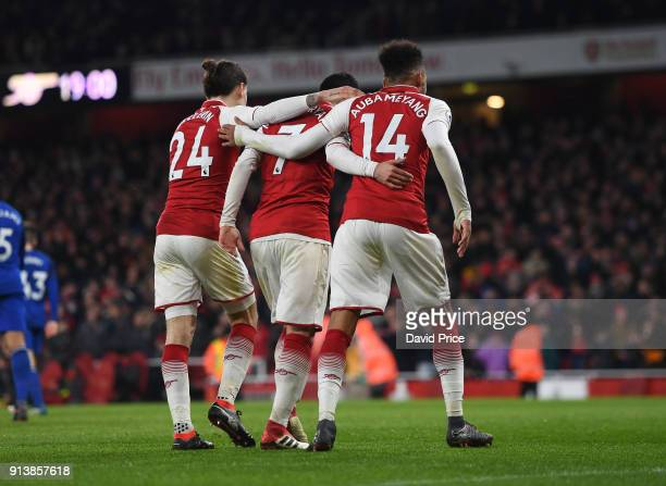 Henrikh Mkhitaryan Hector Bellrin and PierreEmerick Aubameyang of Arsenal celebrate the 5th Arsenal goal the match the Premier League match between...