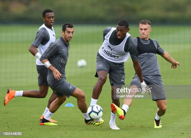 Henrikh Mkhitaryan Jeff ReineAdeliade and Aaron Ramsey of Arsenal during a training session at London Colney on July 20 2018 in St Albans England
