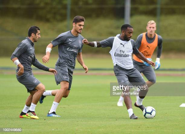 Henrikh Mkhitaryan Konstantinos Mavropanos and Alex Lacazette of Arsenal during a training session at London Colney on July 20 2018 in St Albans...