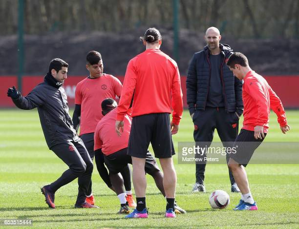 Henrikh Mkhitaryan Marcos Rojo Paul Pogba Ander Herrera and Zlatan Ibrahimovic of Manchester United in action during a first team training session at...
