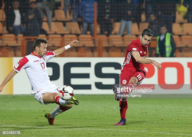 Henrikh Mkhitaryan of Armenia in action against Elsad Zverotic of Montenegro during the FIFA World Cup 2018 qualifying match between Armenia and...