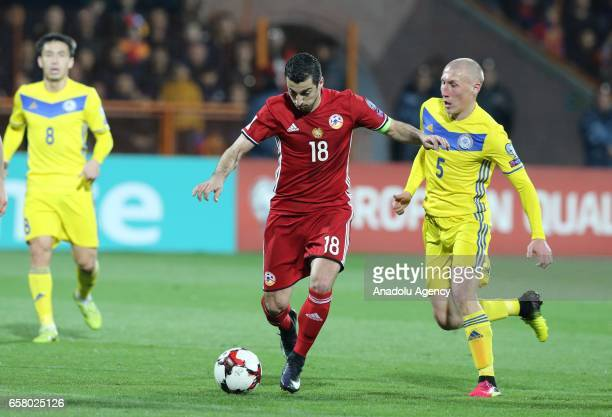 Henrikh Mkhitaryan of Armenia in action against Islambek Kua of Kazakhstan during the FIFA 2018 World Cup Qualifying Round football match between...