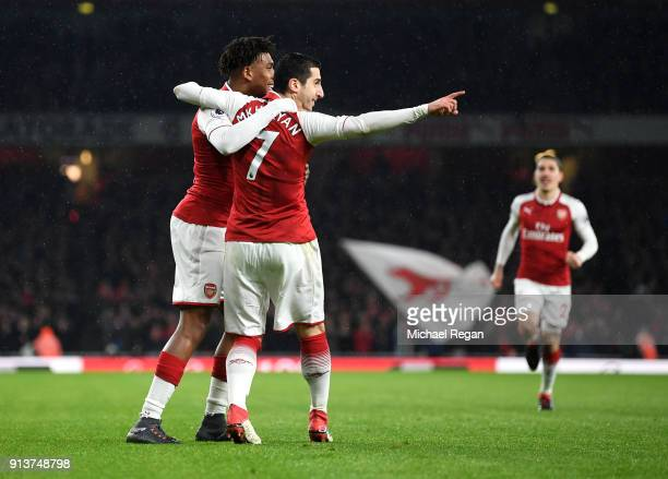 Henrikh Mkhitaryan of Arsenal and Alex Iwobi of Arsenal celebrate their sides first goal during the Premier League match between Arsenal and Everton...