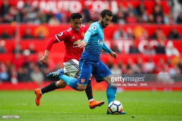 Henrikh Mkhitaryan of Arsenal and Alexis Sanchez of Manchester United during the Premier League match between Manchester United and Arsenal at Old...