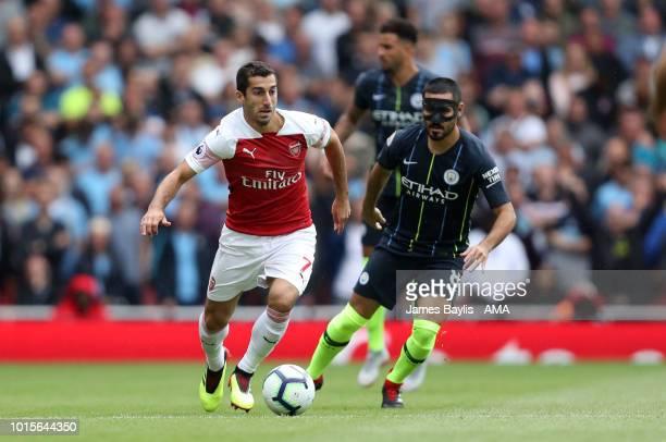 Henrikh Mkhitaryan of Arsenal and Ilkay Gundogan of Manchester City during the Premier League match between Arsenal FC and Manchester City at...