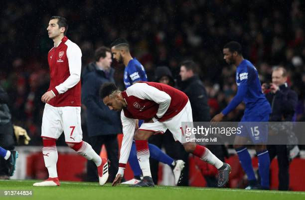 Henrikh Mkhitaryan of Arsenal and PierreEmerick Aubameyang of Arsenal walk onto the pitch prior to the Premier League match between Arsenal and...