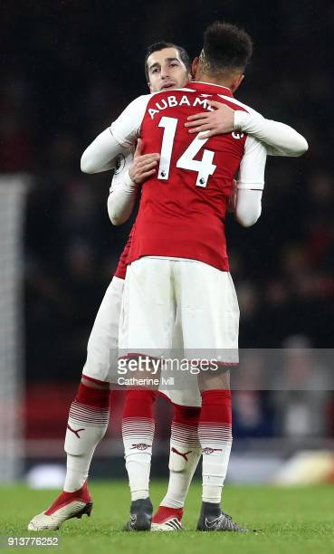 Henrikh Mkhitaryan of Arsenal and PierreEmerick Aubameyang of Arsenal celebrate victory together after the Premier League match between Arsenal and...