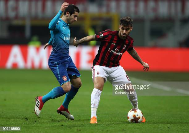 Henrikh Mkhitaryan of Arsenal and Suso of AC Milan during the UEFA Europa League Round of 16 match between AC Milan and Arsenal at the San Siro on...