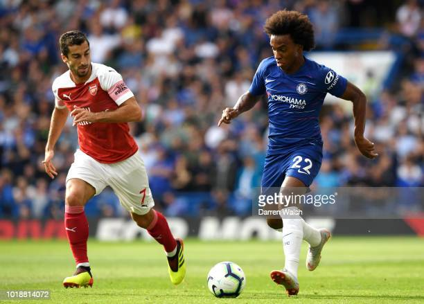 Henrikh Mkhitaryan of Arsenal and Willian of Chelsea battle for the ball during the Premier League match between Chelsea FC and Arsenal FC at...