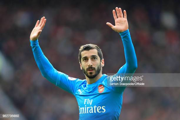 Henrikh Mkhitaryan of Arsenal apologises to the home fans as he celebrates after scoring their 1st goal during the Premier League match between...