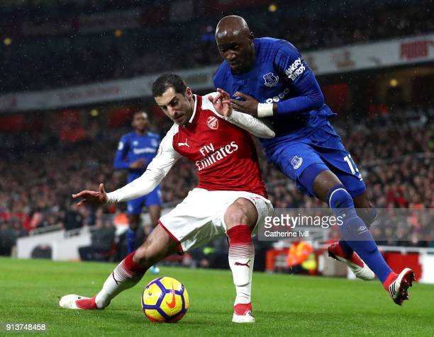 Henrikh Mkhitaryan of Arsenal battles for possesion with Eliaquim Mangala of Everton during the Premier League match between Arsenal and Everton at...