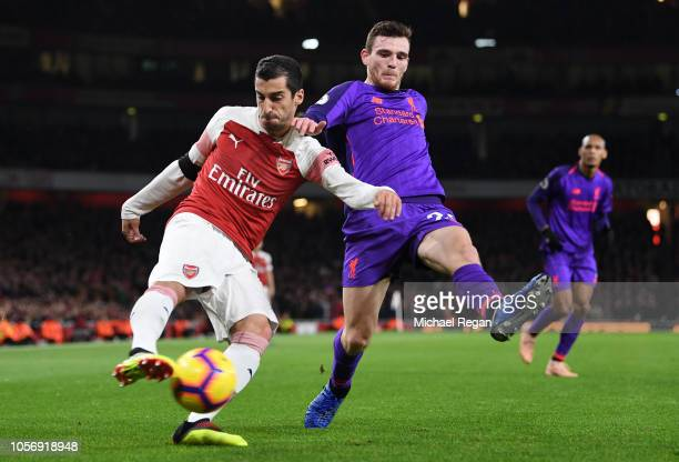 Henrikh Mkhitaryan of Arsenal battles for possession with Andy Robertson of Liverpool during the Premier League match between Arsenal FC and...
