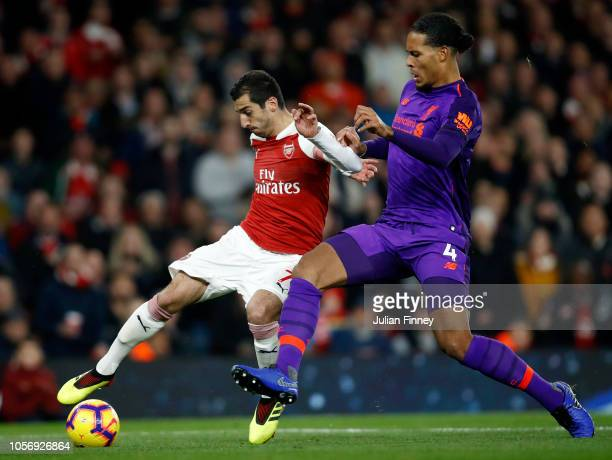 Henrikh Mkhitaryan of Arsenal battles for possession with Virgil van Dijk of Liverpool during the Premier League match between Arsenal FC and...