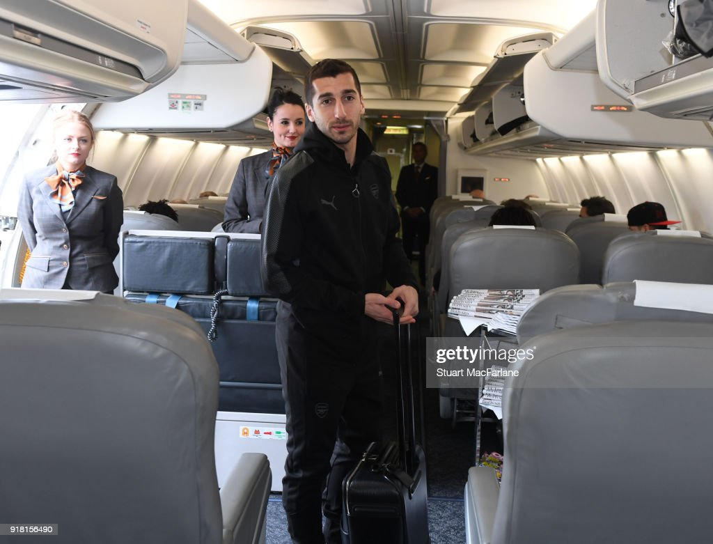 Henrikh Mkhitaryan of Arsenal boards the team flight at Luton Airport on February 14, 2018 in Luton, United Kingdom.