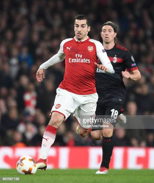 Henrikh Mkhitaryan of Arsenal breaks Riccardo Montolivo of Milan during UEFA Europa League Round of 16 match between AC Milan and Arsenal at Emirates...