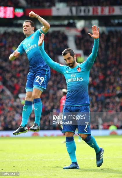 Henrikh Mkhitaryan of Arsenal celebrates after scoring his sides first goal with Granit Xhaka of Arsenal during the Premier League match between...
