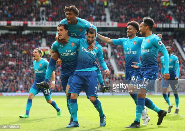 Henrikh Mkhitaryan of Arsenal celebrates after scoring his sides first goal with Granit Xhaka of Arsenal Alex Iwobi of Arsenal Reiss Nelson of...