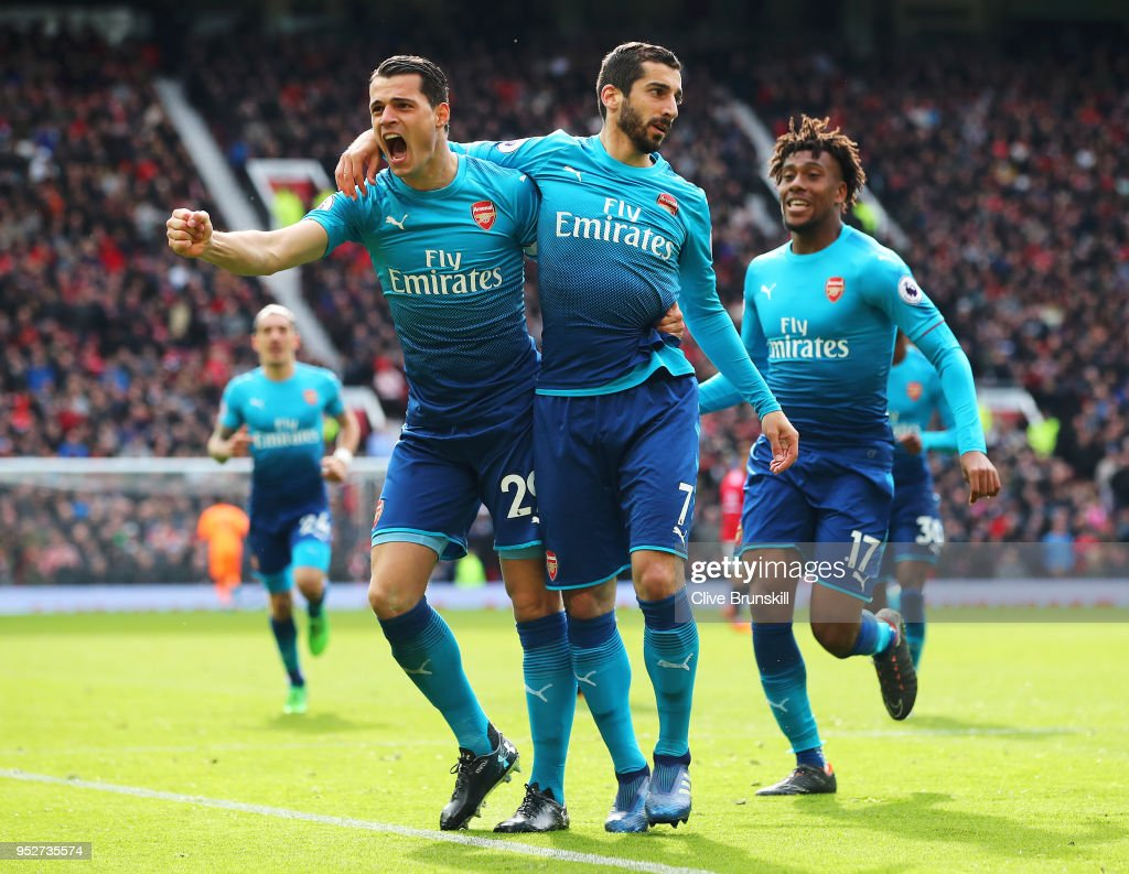 Henrikh Mkhitaryan of Arsenal celebrates after scoring his sides first goal with Granit Xhaka of Arsenal and Alex Iwobi of Arsenal during the Premier League match between Manchester United and Arsenal at Old Trafford on April 29, 2018 in Manchester, England.