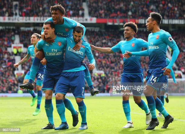 Henrikh Mkhitaryan of Arsenal celebrates after scoring his sides first goal with Granit Xhaka of Arsenal Alex Iwobi of Arsenal Reiss Nelson of...