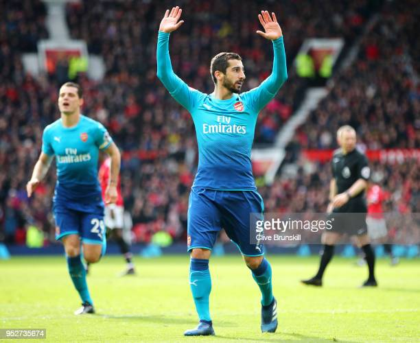 Henrikh Mkhitaryan of Arsenal celebrates after scoring his sides first goal during the Premier League match between Manchester United and Arsenal at...